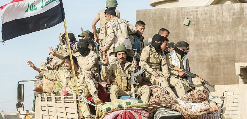 """Syrie/Irak: encerclé à Raqa, l'EI commence à """"s'effondrer"""" à Mossoul"""