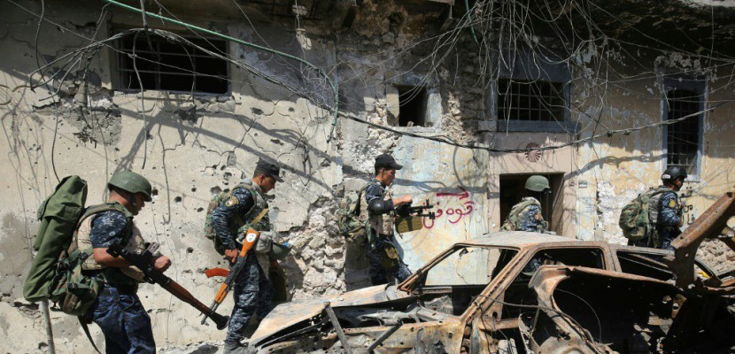 Irak: acculés dans Mossoul, les jihadistes ciblent aussi les civils