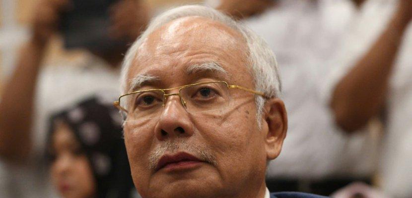 Malaisie: Najib, interdit de voyager, abandonne ses fonctions politiques