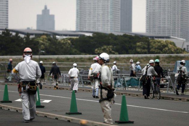 Sueur, peur et danger sur les chantiers des JO de Tokyo