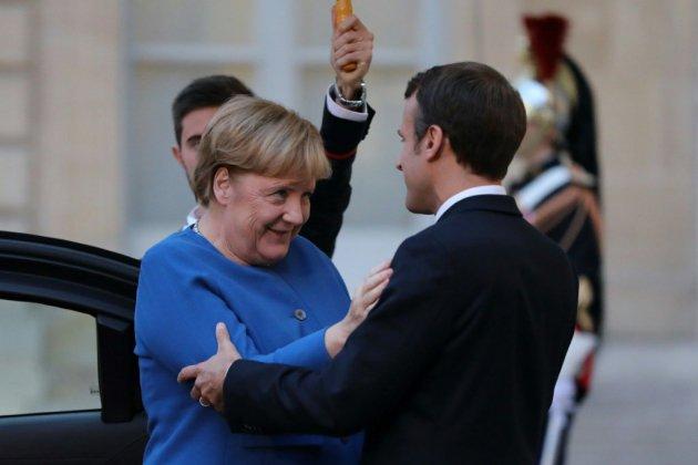 Macron retrouve Merkel à Toulouse avant un sommet à Bruxelles