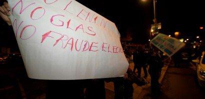 Des partisans du candidat de droite Guillermo Lasso à la présidentiel en Equateur manifestent à Quito, le 20 février 2017    RODRIGO BUENDIA [AFP]