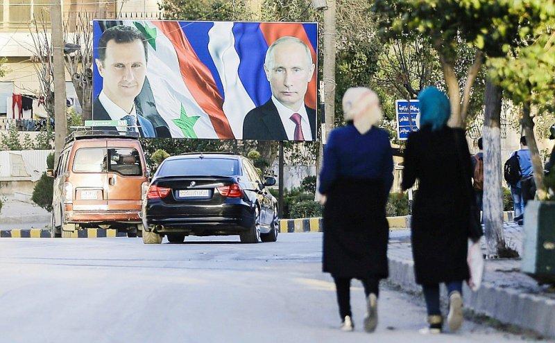 Les portraits du présiden syrien Bachar al-Assad et du président russe Vladimir Poutine, le 9 mars 2017, à Alep, en Syrie    JOSEPH EID [AFP/Archives]