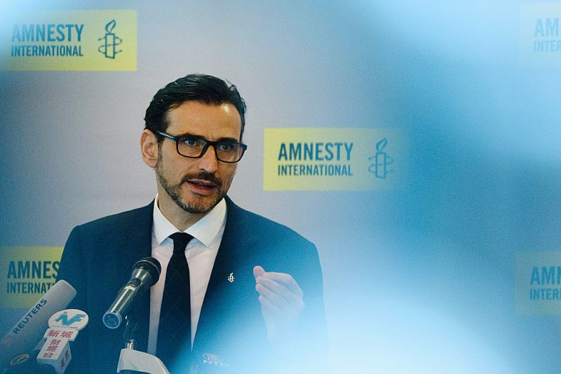 Le directeur de la région Asie de l'Est pour Amnesty International, Nicholas Bequelin, le 10 avril 2017 à Hong Kong - ANTHONY WALLACE [AFP]
