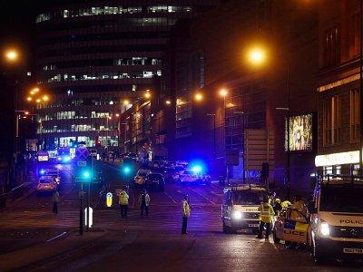 Des policiers sur les lieux de l'attentat à Manchester, en Angleterre, le 23 mai 2017    PAUL ELLIS [AFP]
