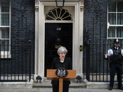 Devant Downing Street, Theresa May fait une déclaration sur l'attentat à Londres le 4 juin 2017    Justin TALLIS [AFP]