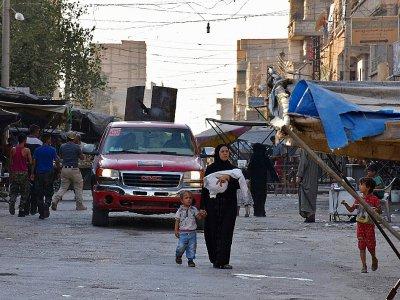 Dans une rue de Deir Ezzor, en Syrie, le 10 septembre 2017 - George OURFALIAN [AFP]