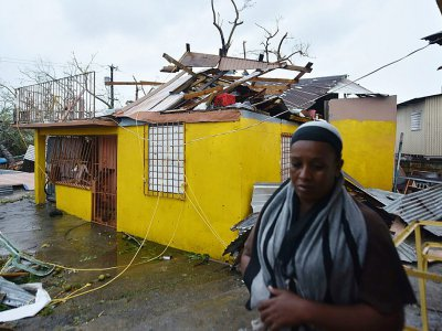 Residents of San Juan deal with damage to their homes - HECTOR RETAMAL [AFP]