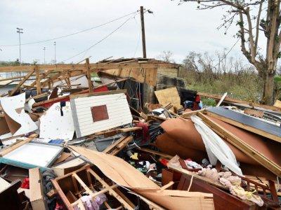 Des maisons détruites à Catano, sur l'île de Porto Rico, le 21 septembre 2017 après le passage de l'ouragan Maria - HECTOR RETAMAL [AFP]