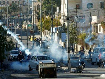 Heurts entre manifestants palestiniens et soldats israéliens dans la ville de Bethléem en Cisjordanie occupée, le 9 décembre 2017 - Musa AL SHAER [AFP]