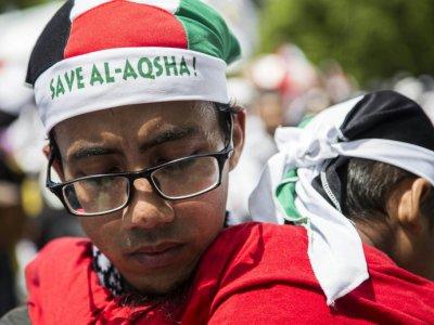Des Indonésiens manifestent contre la reconnaissance par Donald Trump de Jérusalem comme capitale d'Israël à Jakarta, le 10 décembre 2017    DONAL HUSNI, DONAL HUSNI [AFP]