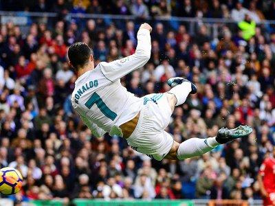 Cristiano Ronaldo à l'œuvre, le 9 décembre 2017 lors du match Real Madrid-Séville - PIERRE-PHILIPPE MARCOU [AFP/Archives]