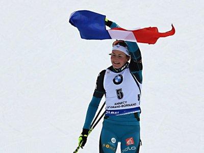 Justine Braisaz remporte sa première course en Coupe du monde de biathlon, la mass start du Grand-Bornand (Haute-Savoie, le 17 décembre 2017    JEAN-PIERRE CLATOT [AFP]