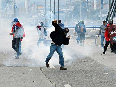 Des opposants honduriens protestent contre la réelection du président Juan Orlando Hernandez, le 27 janvier 2018 à Tegucigalpa    Orlando SIERRA [AFP]