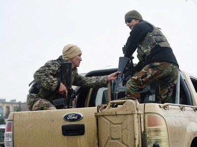 Des membres des forces de sécurité près de l'Académie militaire de Kaboul où s'est déroulé une attaque meurtrière le 29 janvier 2018    WAKIL KOHSAR [AFP]