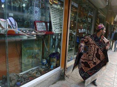 Vendeur de tapis dans Chicken Street à Kaboul, le 7 décembre 2014    WAKIL KOHSAR [AFP/Archives]