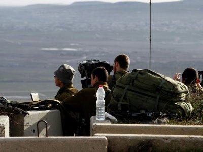 Des soldats israéliens prennent position sur le Golan occupé à la frontière avec la Syrie, le 10 février 2018 - JALAA MAREY [AFP]