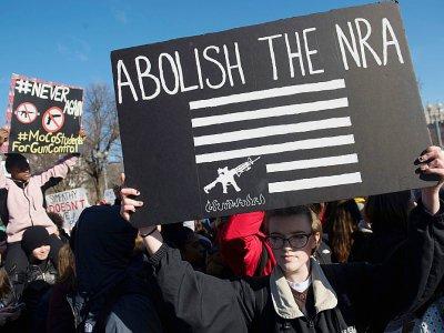 Des milliers de jeunes rassemblés à Washington le 14 mars 2018, en soutien aux survivants de la fusillade de Parkland    SAUL LOEB [AFP]