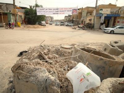 Une bannière appelle les Irakiens à boycotter les élections législatives dans un quartier de Bassora (sud) le 8 mai 2018 alors que les habitants de cette région se plaignent d'être négligés par les autorités fédérales    HAIDAR MOHAMMED ALI [AFP]