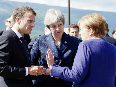 Le président français Emmanuel Macron, la Première ministre britannique Theresa May et la chancelière allemande Angela Merkel, ici le 22 mai 2018 lors d'un sommet UE-Balkans à Sofia, tentent de maintenir en vie l'accord sur le nucléaire iranien dénon    Stephane LEMOUTON [POOL/AFP/Archives]