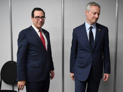 Le ministre français de l'Economie et des Finances, Bruno Le Maire (d) et le secrétaire américain au Trésor Steve Mnuchin, le 21 juillet 2018 au sommet du G20 à Buenos Aires, en Argentine    EITAN ABRAMOVICH [AFP]