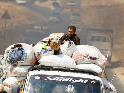 Des familles syriennes, fuiyant les combats à Idleb, arrivent dans un camp près de la frontière avec la Turquie, le 9 septembre 2018    Aaref WATAD [AFP/Archives]