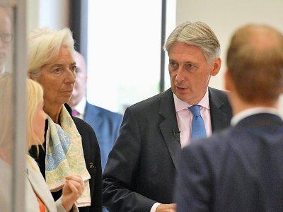 Le ministre britannique des Finances Philip Hammond et la directrice générale du FMI Christine Lagarde à Londres le 17 septembre 2018 - John Stillwell [POOL/AFP]