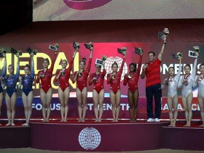 Les Américaines médaille d'or par équipes devant la Russie et la Chine aux Mondiaux de gymnastique de Doha le 30 octobre 2018    KARIM JAAFAR [AFP]