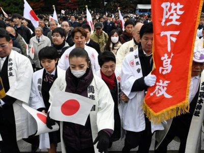 Des Japonais entrent dans le Palais impérial de Tokyo pour la cérémonie publique marquant le 85e anniversaire de l'Empereur Akihito, le 23 décembre 2018    Toshifumi KITAMURA [AFP]