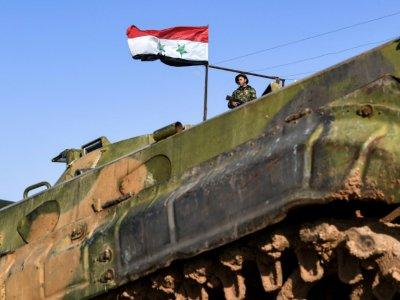 Un soldat du régime syrien dans le village de Hawshariya (nord de la Syrie), le 12 janvier 2019    George OURFALIAN [AFP]