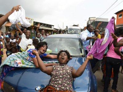 Des Ivoiriens célèbrent l'acquittement par la CPI de l'ancien président Laurent Gbagbo le 15 janvier 2019    ISSOUF SANOGO [AFP]