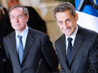 Claude Guéant et Nicolas Sarkozy, le 13 avril 2012 à Ajaccio - PASCAL POCHARD CASABIANCA [AFP/Archives]