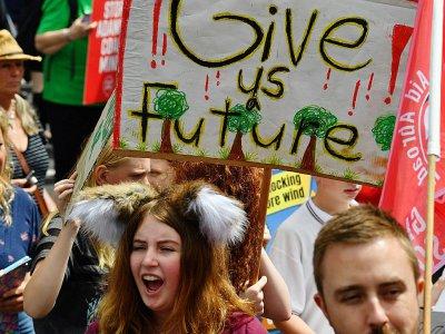 Des jeunes manifestent à Sydney pour sensibiliser au changement climatique, le 15 mars 2019    Saeed KHAN [AFP]