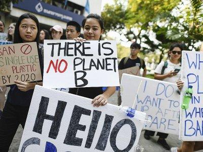 Des manifestants sensibilisent sur le changement climatique, le 15 mars 2019 à Bangkok    Jewel SAMAD [AFP]