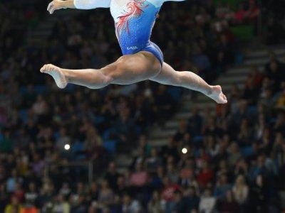 La gymnaste française Mélanie De Jesus Dos Santos médaille d'argent à la poutre lors des championnats d'Europe de Szczecin en Pologne le 14 avril 2019    Janek SKARZYNSKI [AFP]