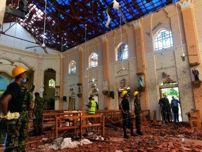Décombres à l'intérieur de l'église Saint-Sébastien de Negombo, le 22 avril 2019 au lendemain d'une série d'explosions meurtrières - ISHARA S. KODIKARA [AFP]