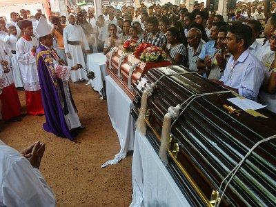 Messe commémorative en hommage aux victimes à l'église Saint-Sébastien de Negombo, le 23 avril 2019 - ISHARA S.  KODIKARA [AFP]