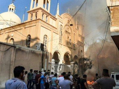 Le lieu où a explosé une voiture piégée près d'une église à Qamichli dans le nord-est de la Syrie, le 11 juillet 2019    Gihad Darwish [AFP]