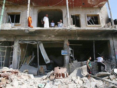 Un immeuble détruit par une frappe aérienne du régime syrien, le 12 juillet 2019 à Maaret al-Noomane - Abdulaziz KETAZ [AFP]