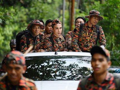 Des membres de l'équipe de recherches pour retrouver la jeune Nora Quoirin, dans la région de Seremban le 13 août 2019    Mohd RASFAN [AFP]