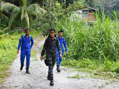 Des membres d'une équipe de recherches pour retrouver la jeune Nora Quoirin disparue en Malaisie, dans la région de Seremban le 13 août 2019    Mohd RASFAN [AFP]