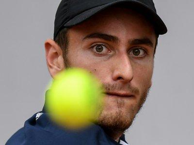 Elliot Benchetrit face au Britannique Cameron Norrie au 1er tour de Roland-Garros, le 28 mai 2019    Christophe ARCHAMBAULT [AFP/Archives]
