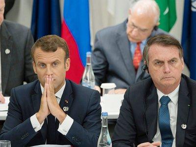 Les présidents français Emmanuel Macron (g) et brésilien Jair Bolsonaro, le 28 juin 2019 au sommet du G20 à Osaka, au Japon - Jacques Witt [POOL/AFP/Archives]