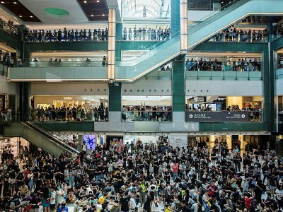 Thousands gathered inside a mall in the northern town of Sha Tin to sing protest songs and make origami cranes