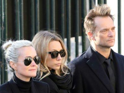 Laeticia Hallyday, Laura Smet et David Hallyday (de G à D) lors des funérailles de Johnny Hallyday à l'église de la Madeleine à Paris le 9 décembre 2017    ludovic MARIN [AFP/Archives]
