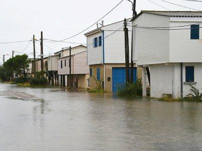 Une rue inondée à Gruissan (Aude) après de fortes précipitations le 23 octobre 2019    Eric CABANIS [AFP]