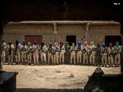 Groupe de miliciens peuls dans un camp de démobilisation à Sévaré, dans le centre du Mali, le 6 juillet 2019    Marco LONGARI [AFP]
