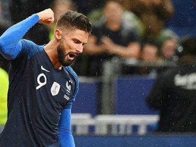 L'attaquant des Bleus Olivier Giroud exulte après avoir inscrit un but contre la Turquie en qualif de l'Euro-2020, le 14 octobre 2019 au Stade de France    MARTIN BUREAU [AFP/Archives]