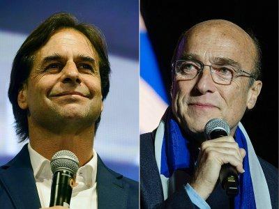 Les deux candidats au deuxième tour de l'élection présidentielle en Uruguay, Luis Lacalle Pou (g) et Daniel Martinez    EITAN ABRAMOVICH                    , PABLO PORCIUNCULA [AFP/Archives]