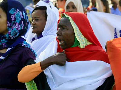 Des Soudanaises manifestent contre les violences faites aux femmes, à Khartoum le 25 novembre 2019 - Ashraf SHAZLY [AFP]
